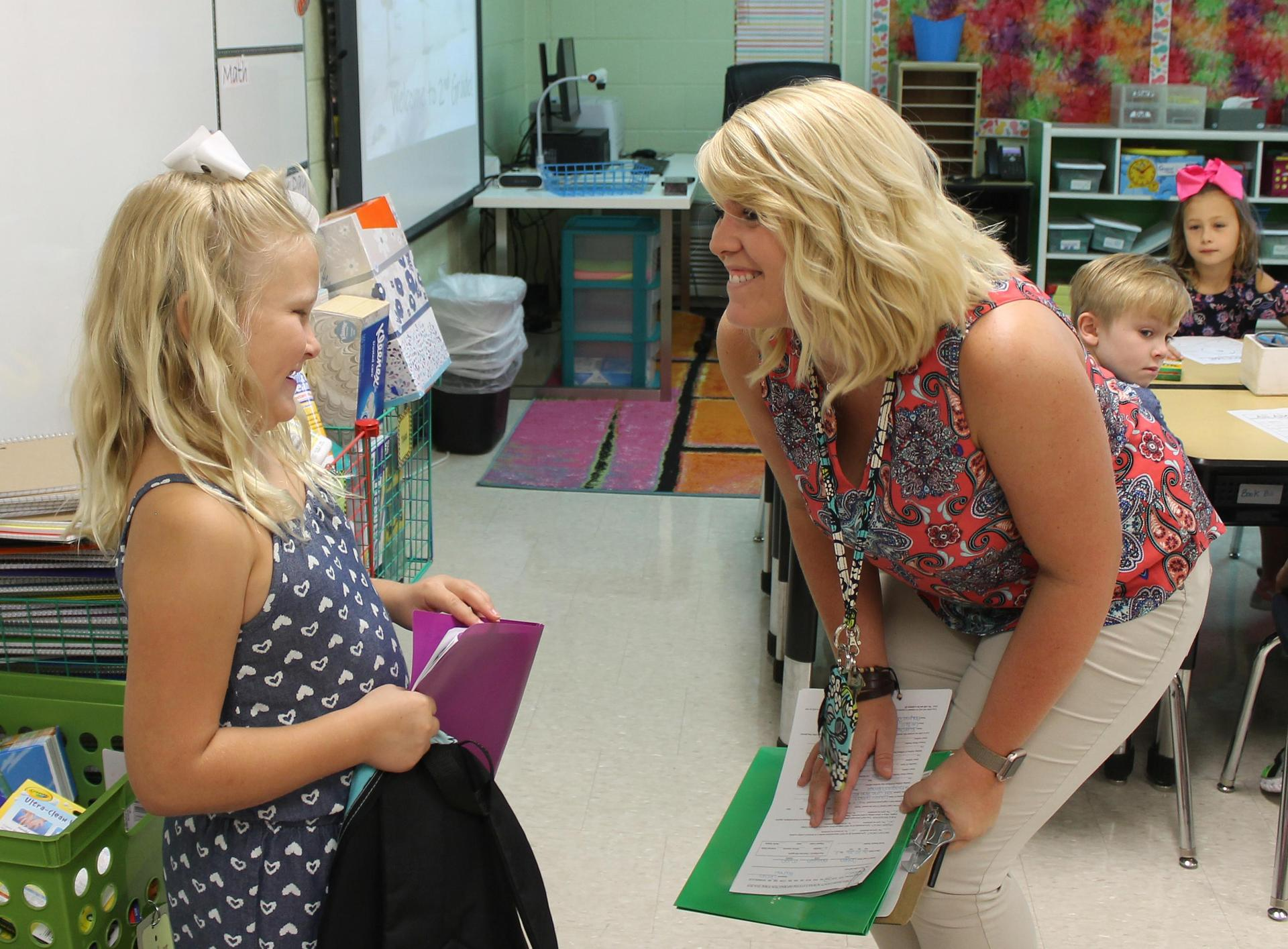 Kingston Springs Elementary School teacher Rachael Dallas welcomes a student on the first day of the 2018-2019 school year.
