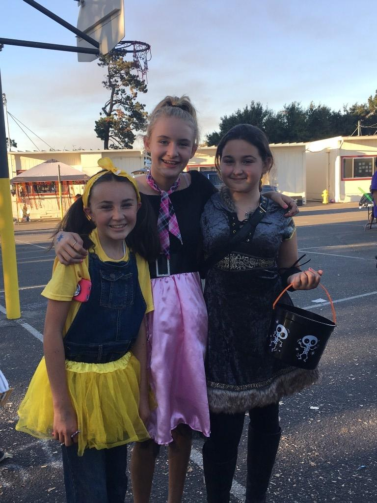 children dressed as minion, poodle skirt girl