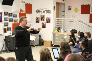 Steve Grussendorf conducting choral students in classroom
