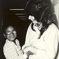 Image of deaf blind student with her childcare worker, Patty B