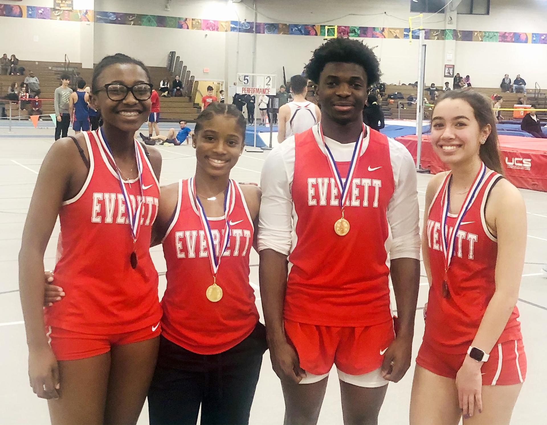 Posed photo, track athletes wearing their medals