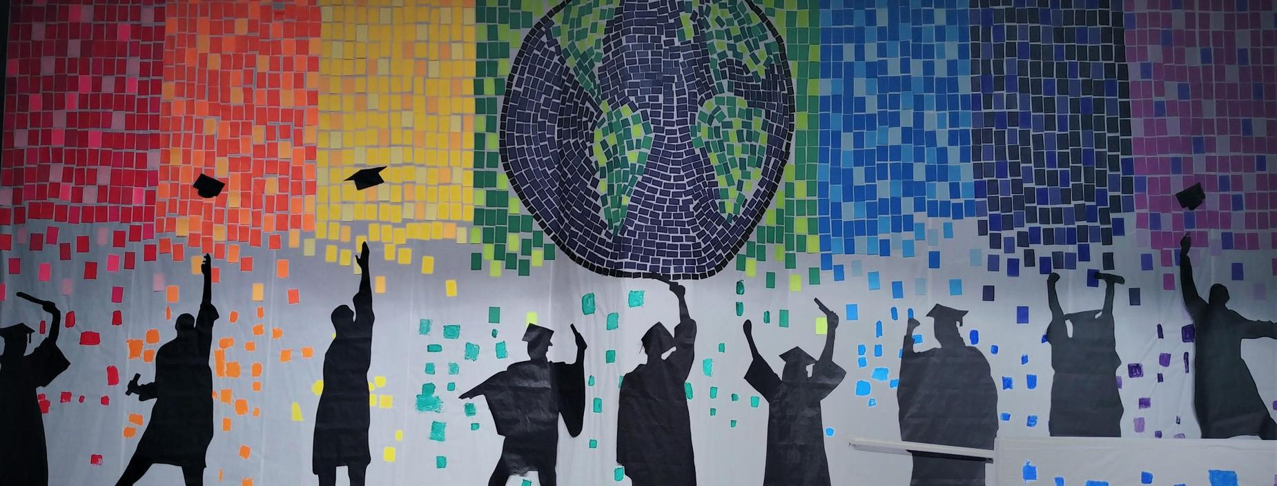 Rainbow mosaic of graduate silhouettes under the world.