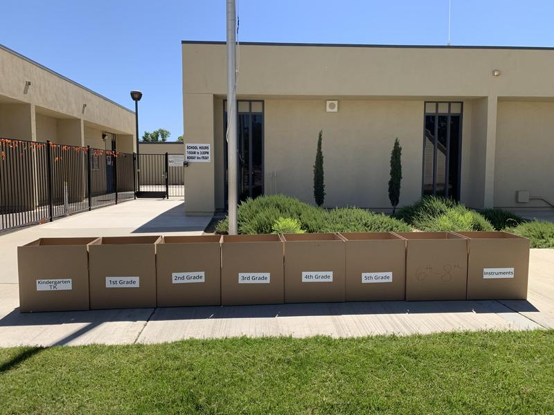 Boxes in front of the school.