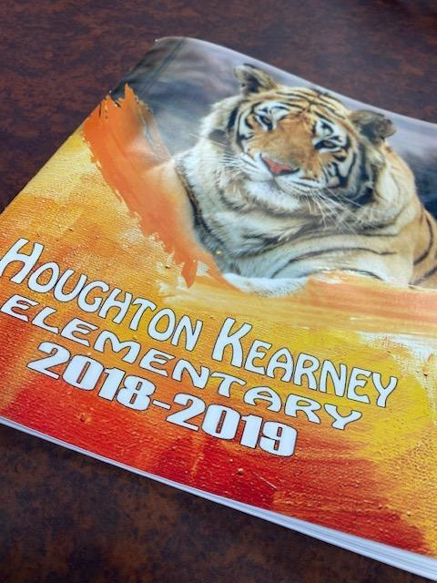 Picture of last year's yearbook with a tiger on front