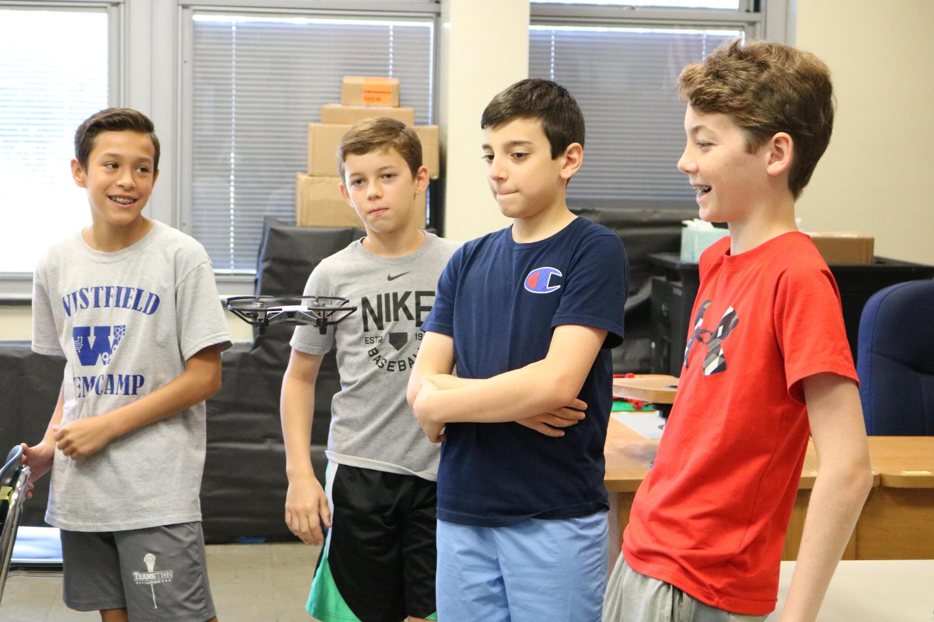 Photo of boys looking at drone at STEM Camp