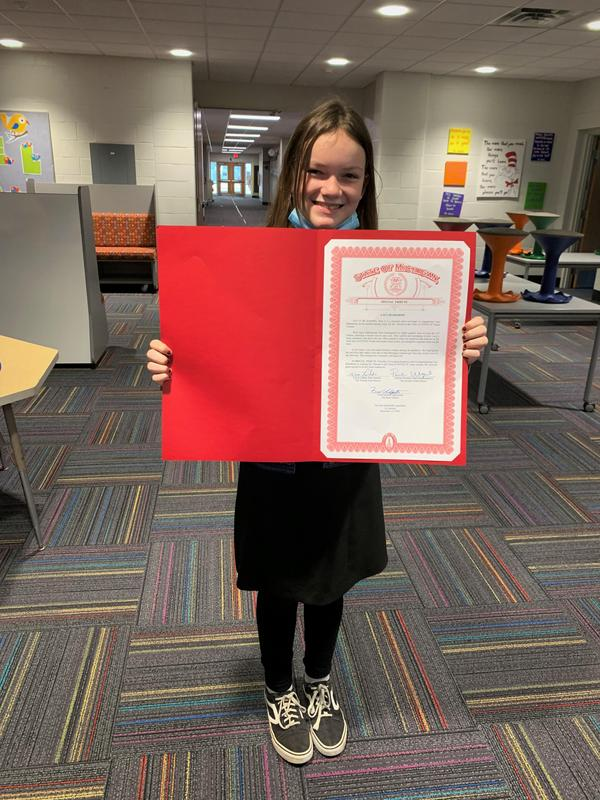 Lacy holding her certificate