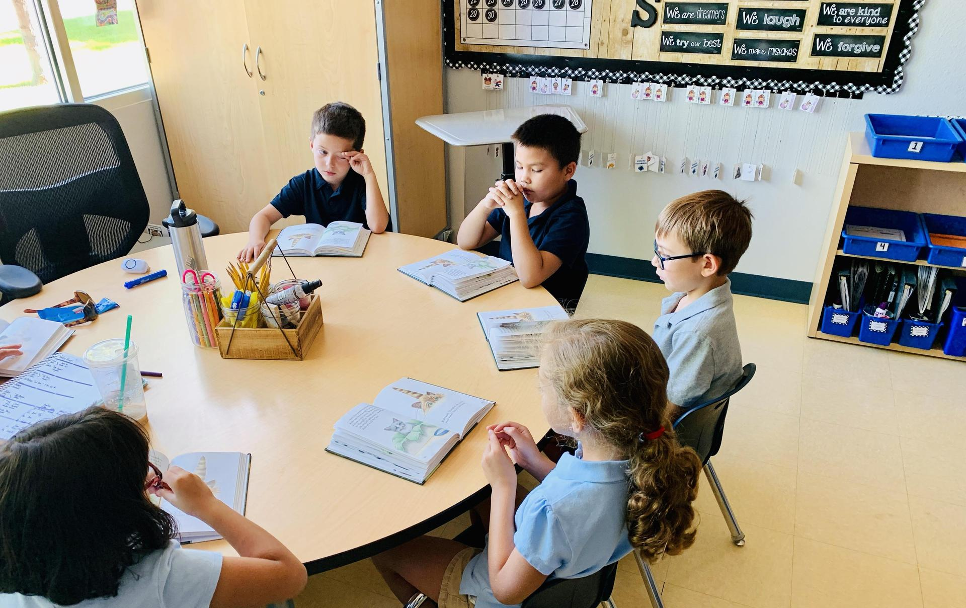 Students read in a small group.