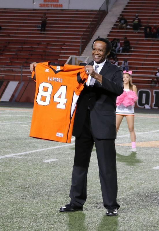 Man holding football jersey