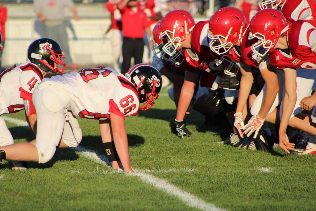 Two football teams on the line of scrimmage