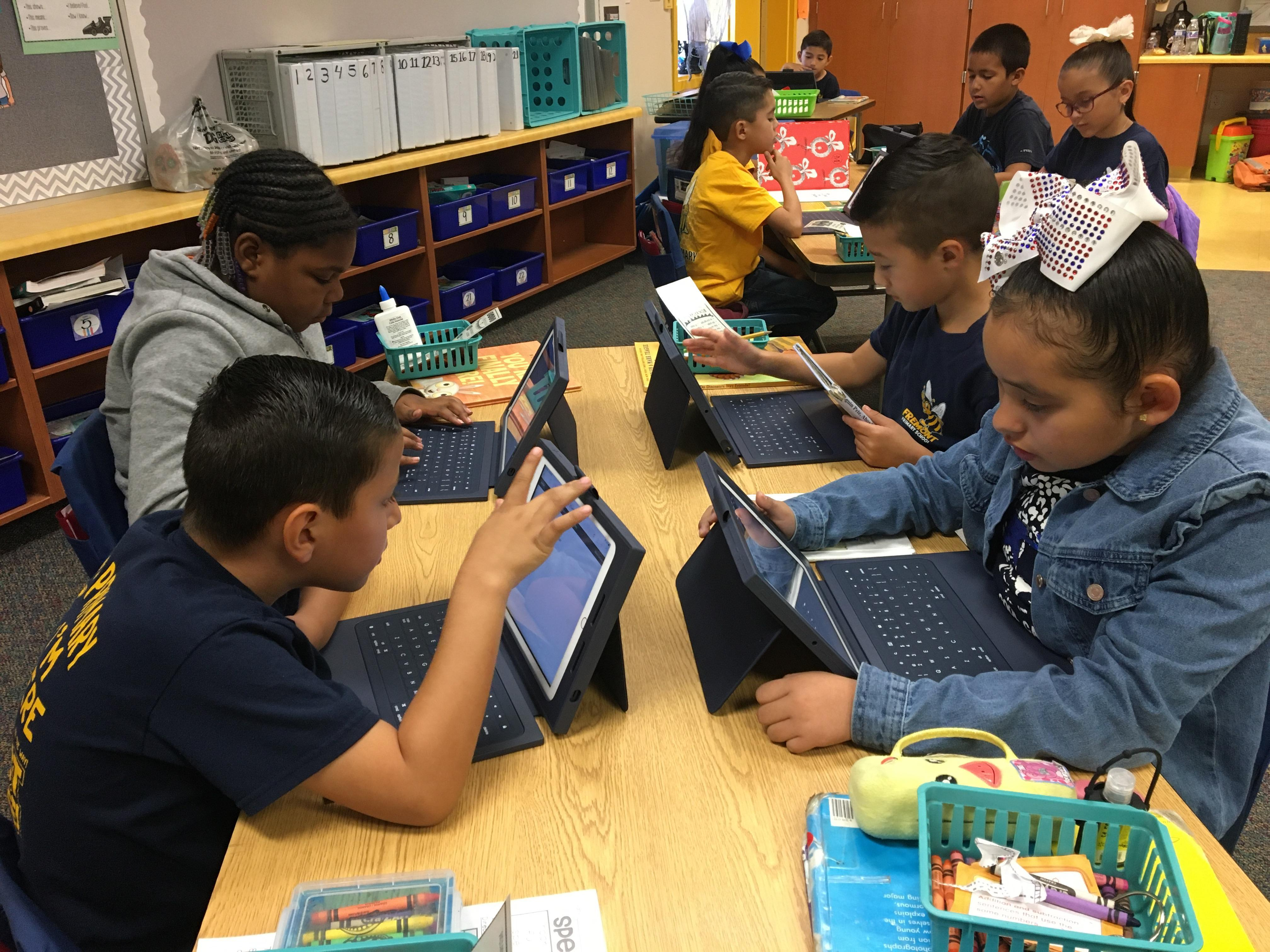 Students using  new iPads