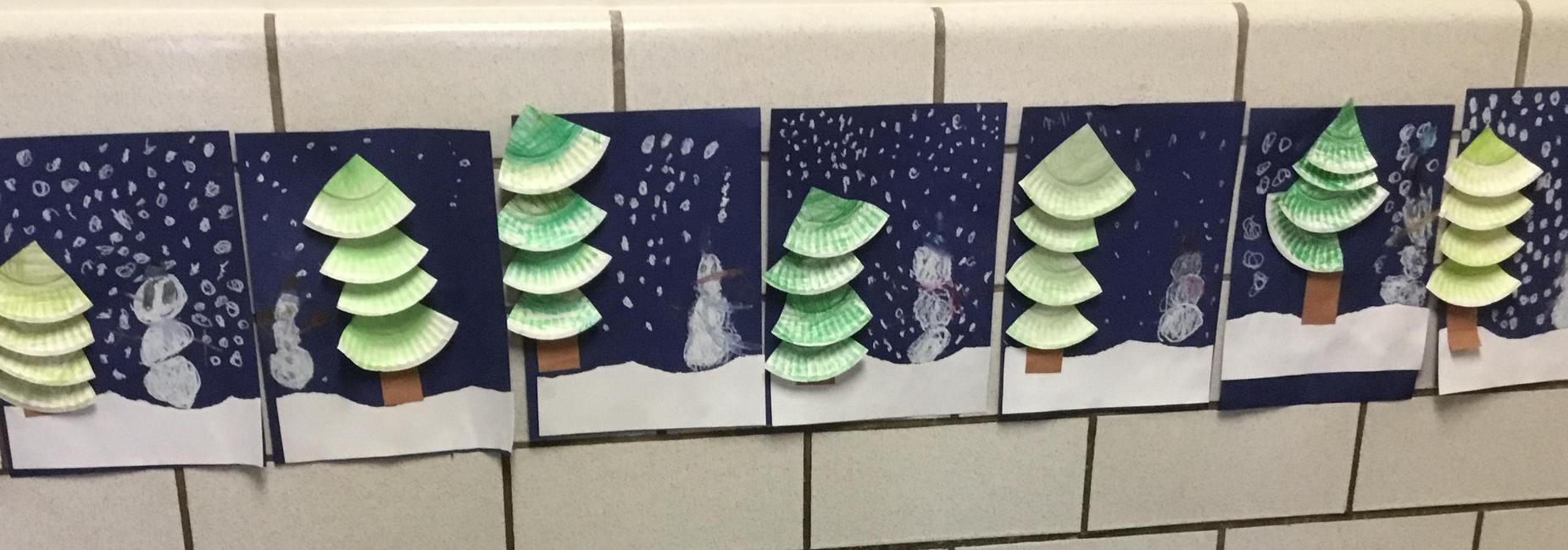 Student artwork trees and snowmen