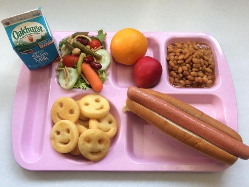 KHS Foot Long Hotdog on a Whole Grain Bun, Baked Smile Potatoes, Salad, Baked Beans, Orange and Plum and Milk
