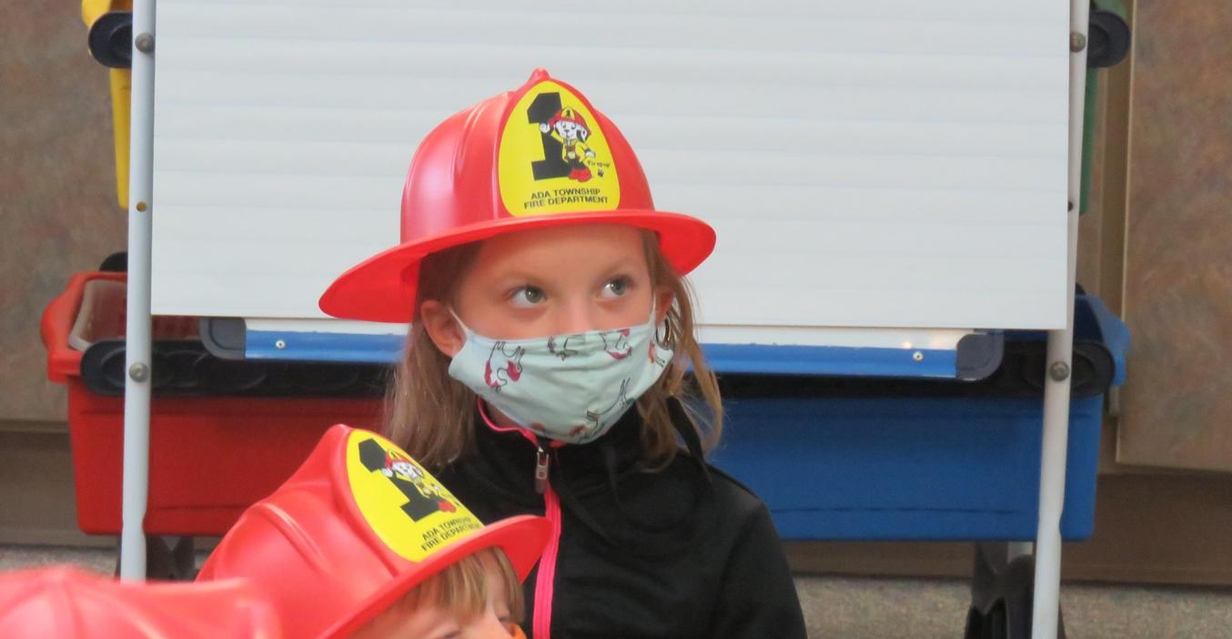A McFall student listens to a firefighter via a Zoom call talk about fire safety.