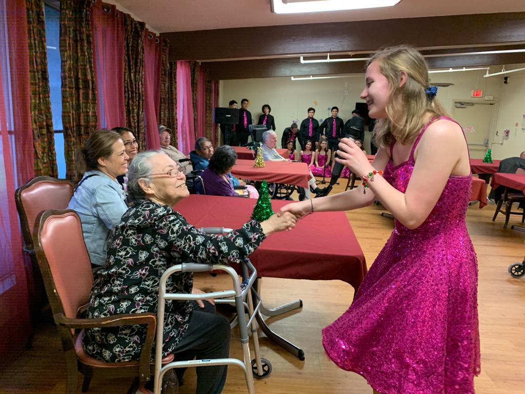 Courtney Smith sings to a Retama Manor Resident
