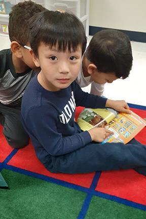 Kindergartner reading book