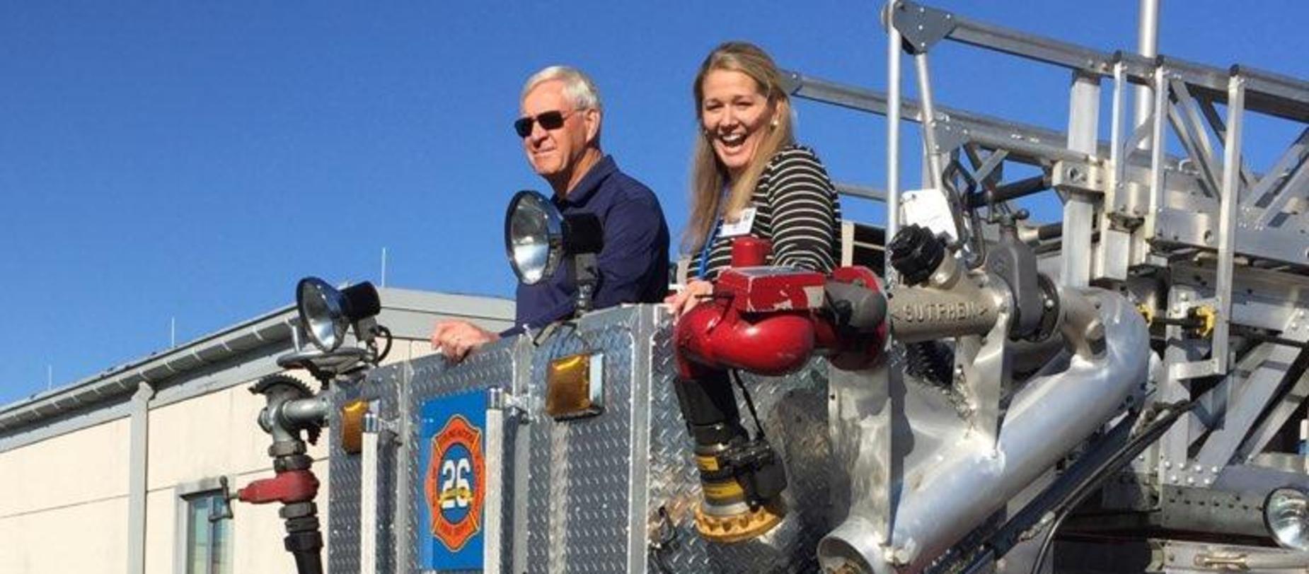 Principal in firetruck bucket