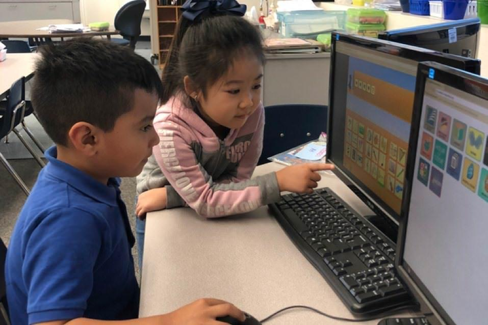 Esther L. Walter student provides computer help to classmate