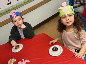 children enjoying cupcakes