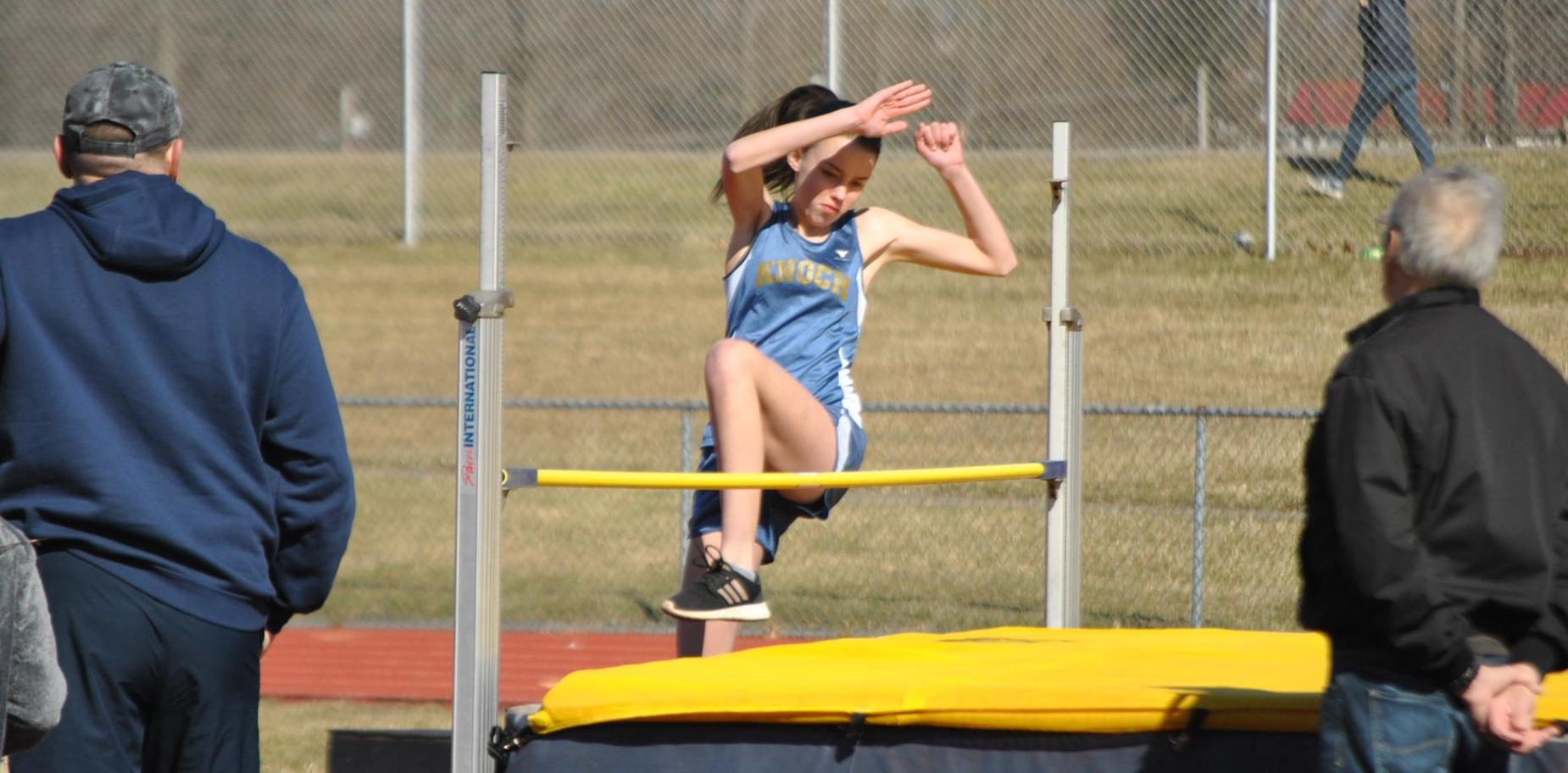 Student doing high jump