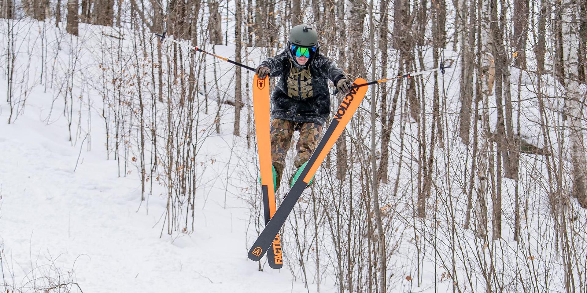 A freestyle skier making a big air jump.