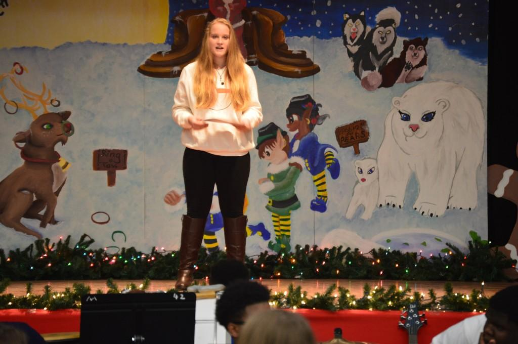 Creative Writing student presenting during the Holiday Arts Gala