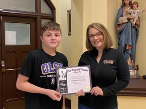 photo of OLSH student receiving scholarship