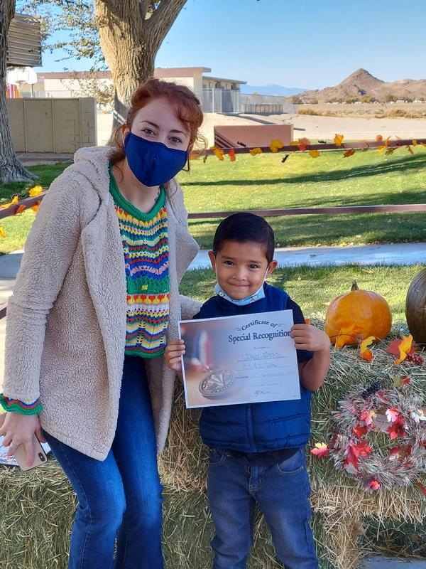 Assembly Mrs. Melissa Almodovar and 1st grader Diego Elorza.jpg
