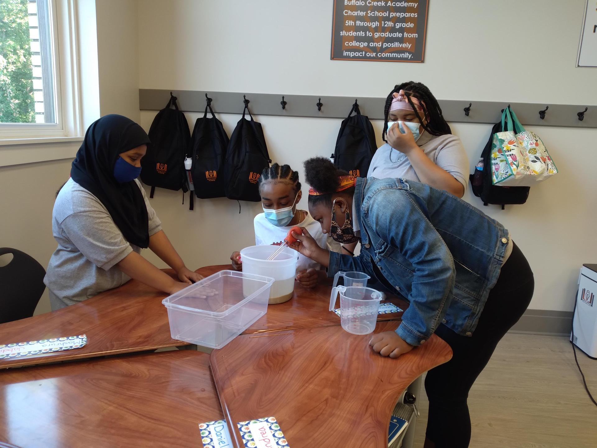 girls doing science in a classroom