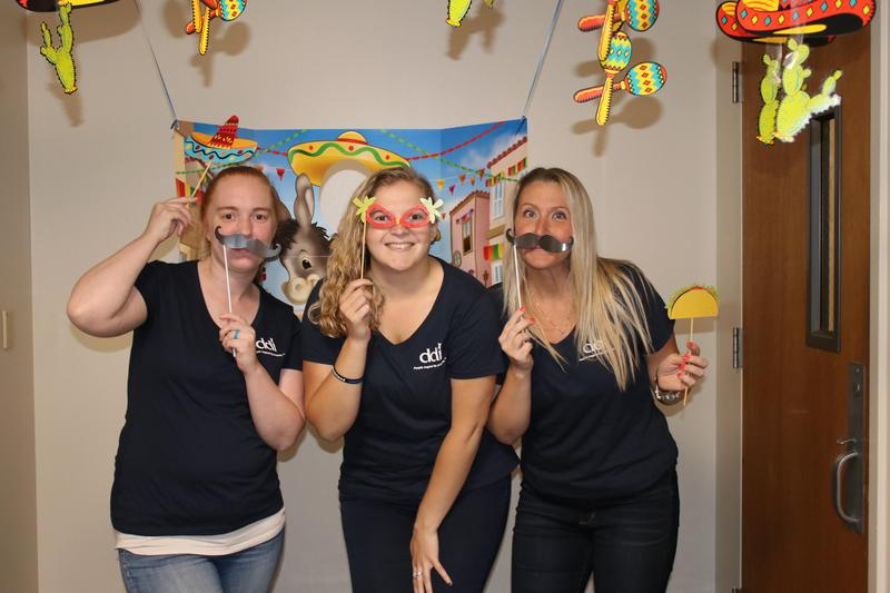 The HR team members with fiesta decorations