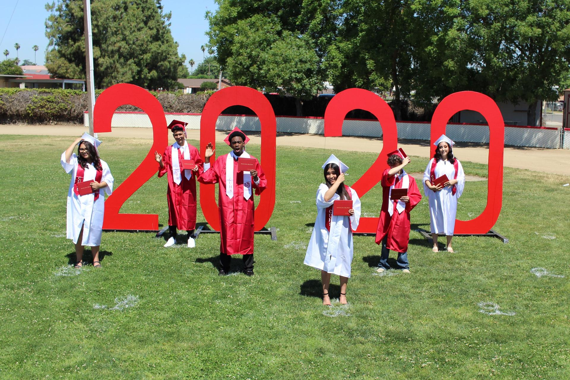 Left to right, Yacqueline Zapata, Andres Martinez Mares, DaJon Davison, Mara Avila, Kyle MacDonald, and Alize Velasco turning their tassels