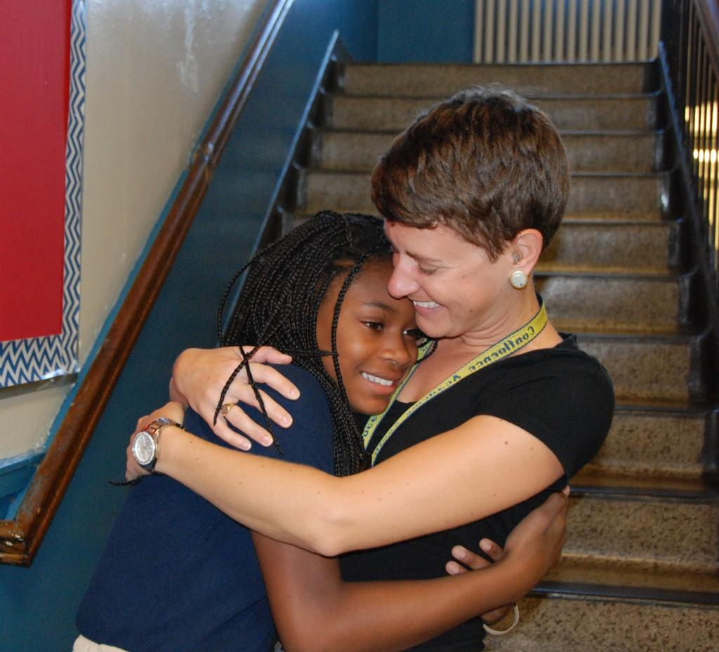 Student and teacher hug, First day of school 2016-17