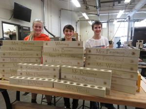Six high school students in the woods production class helped make the crayon holders.