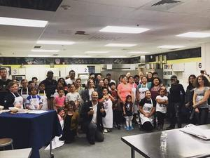 Group photo of YEAH participants and Skyview junior chefs.