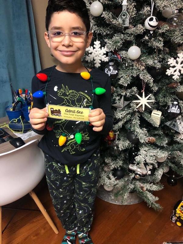 Kylar holding ticket wearing Christmas light necklace
