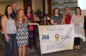 Marti PTA members display National PTA School of Excellence banner