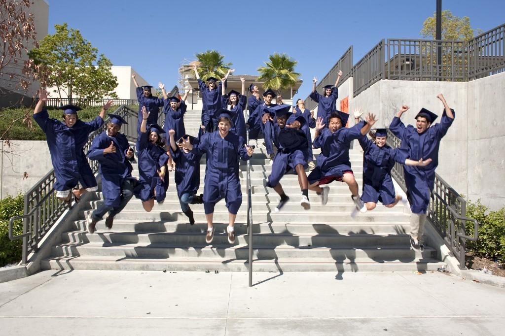 Graduates jumping off of the stairs