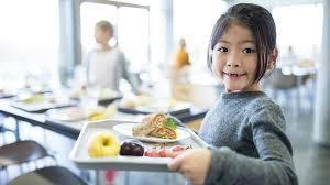 Student holding healthy lunch