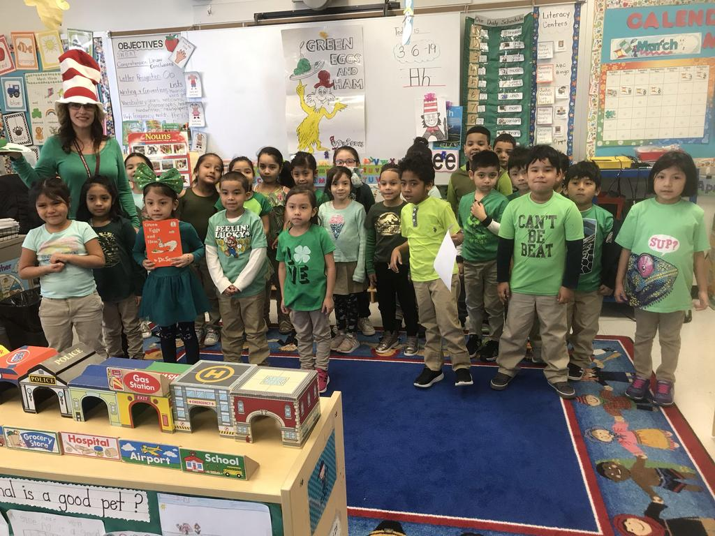 teacher with class wearing green for green eggs and ham