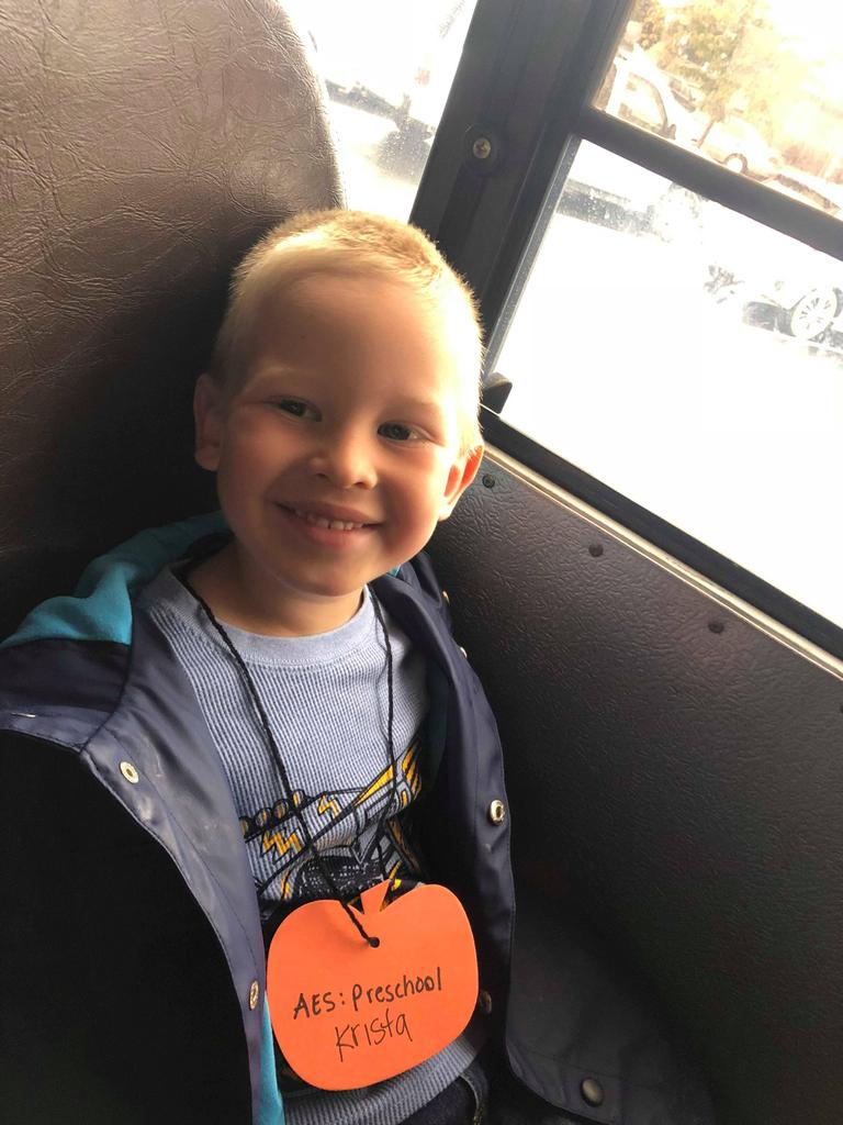 Child sitting on bus