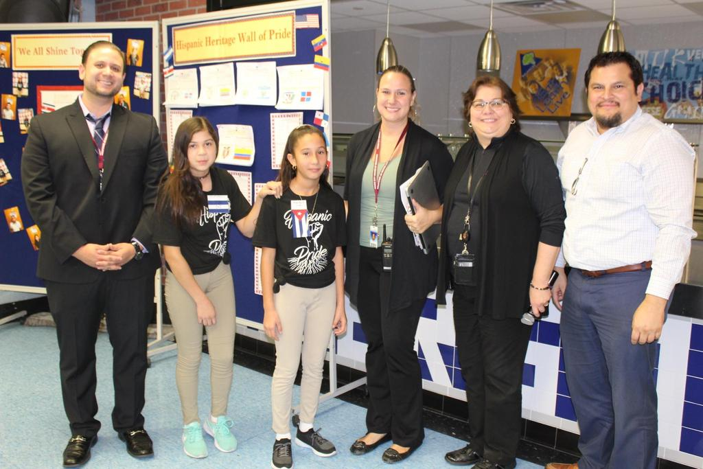 two female students with Mrs. Wilson, Mrs. Rojas, and Mr. Hurtado