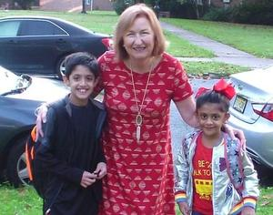 Franklin principal Dr. Eileen Cambria poses with two students she escorted on Walk to School Day.