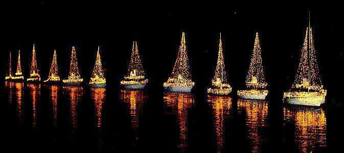 sailboats with holiday lights