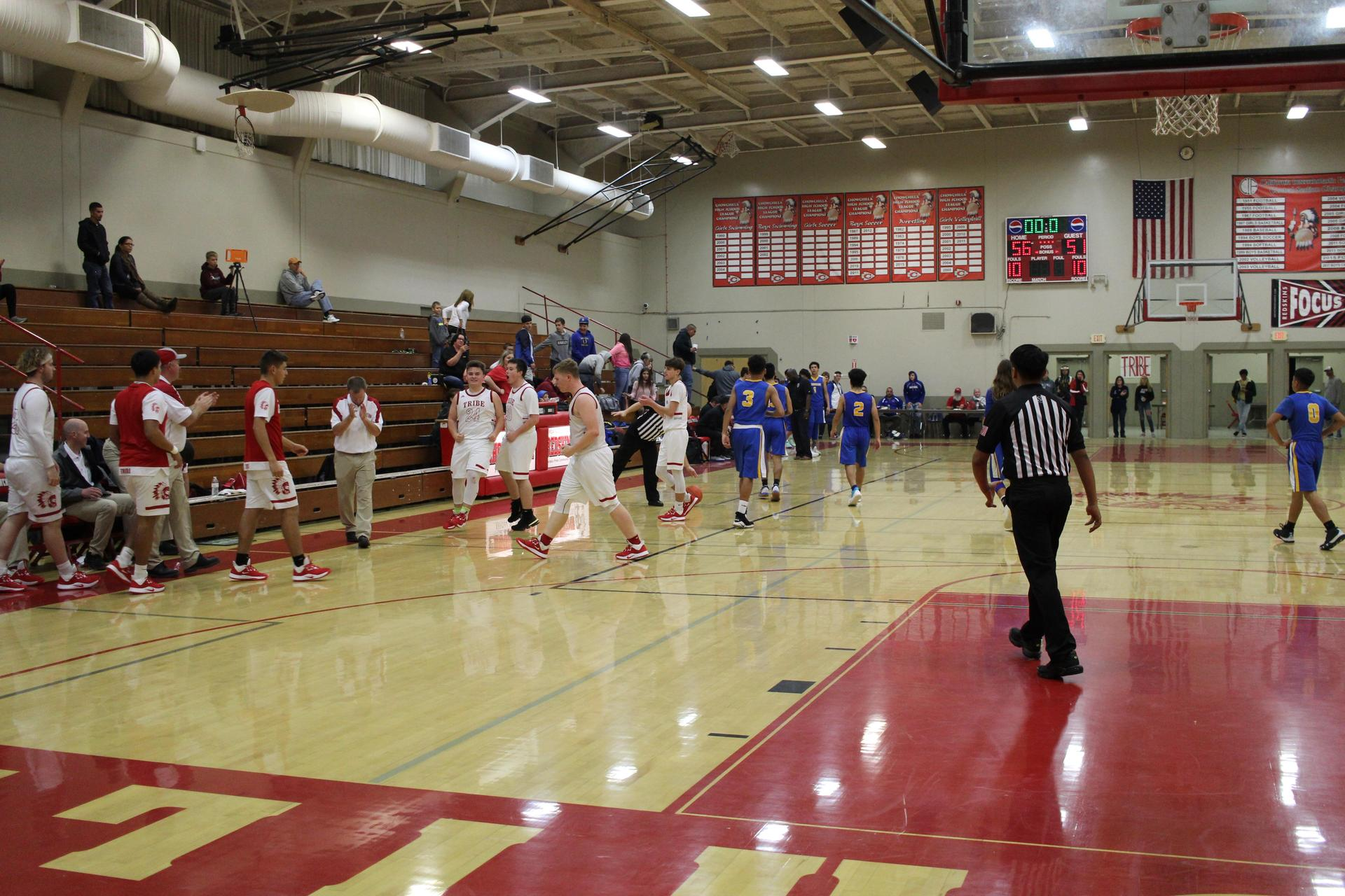 boys playing basketball against dos palos