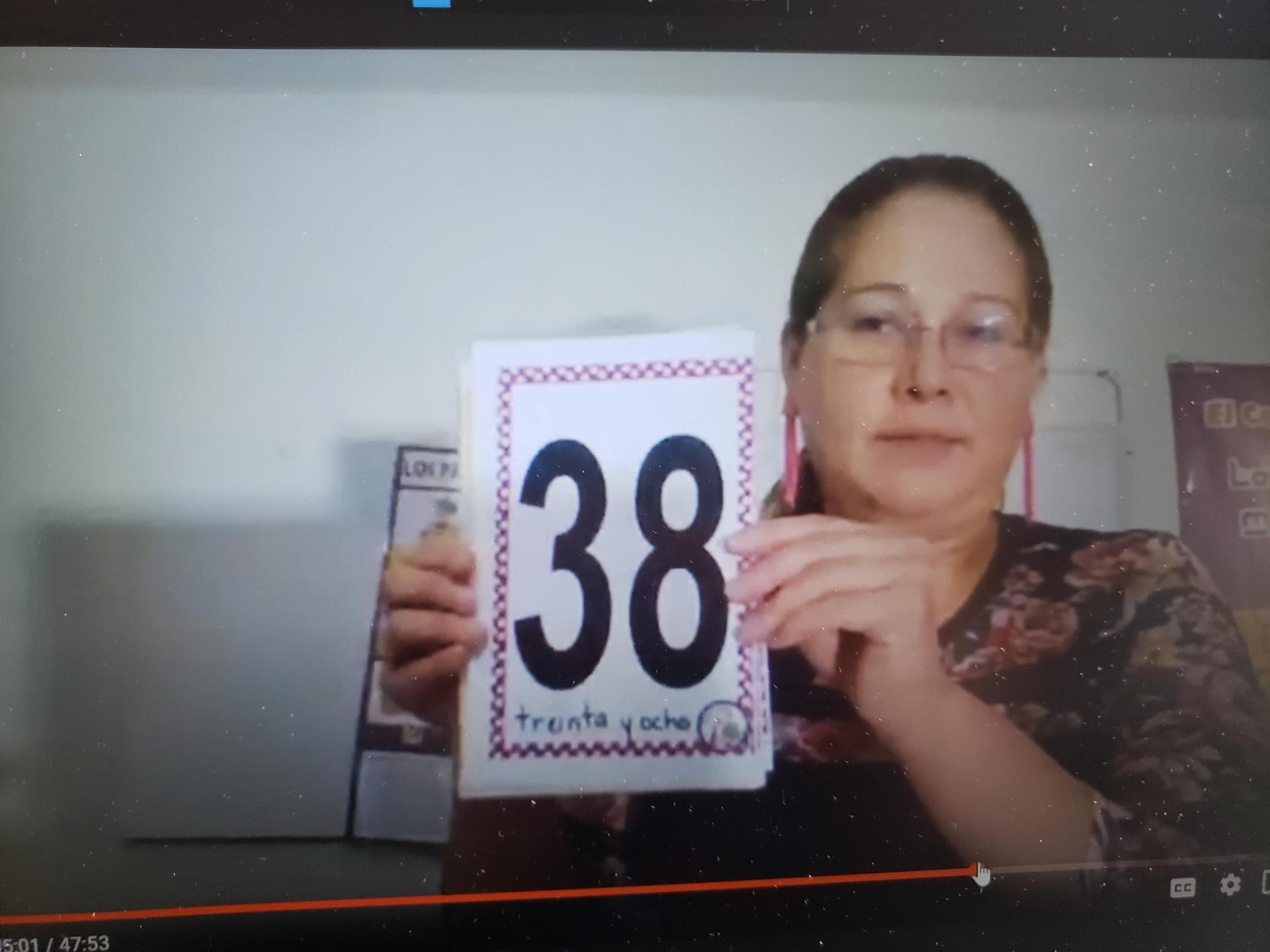Teacher holding up '38'