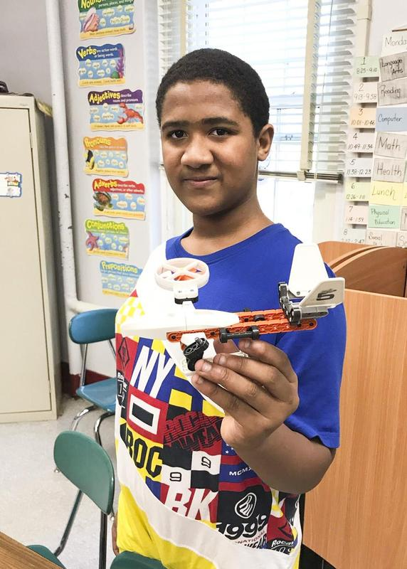 Van Cleve student showing off his completed drone craft.