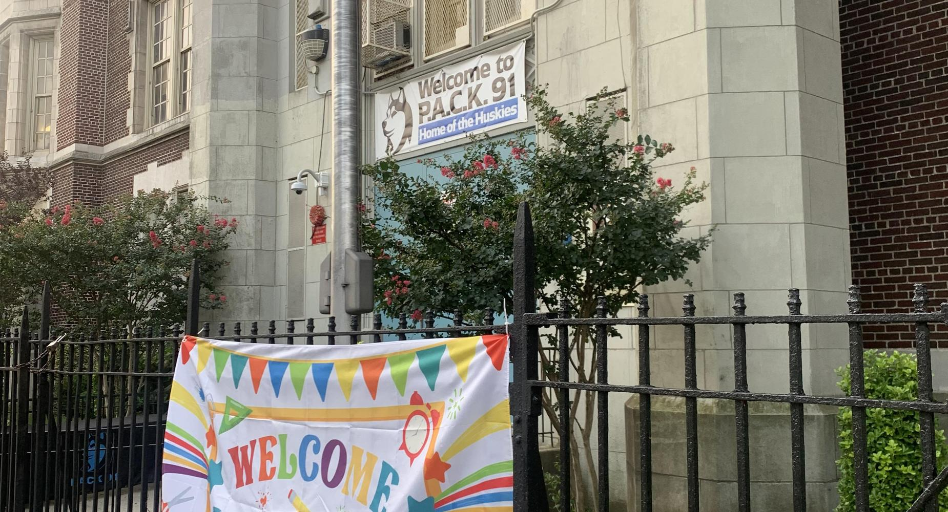 multi colored welcome back to school banner on fence