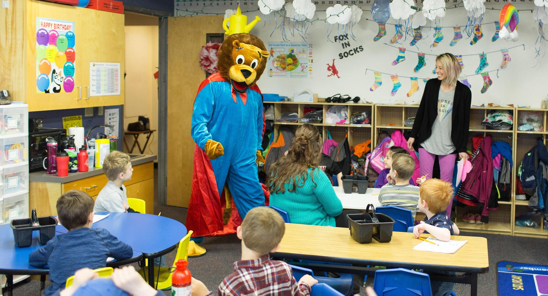 Moscow Charter School's Kevin the Kindness Lion makes a visit to the classrooms
