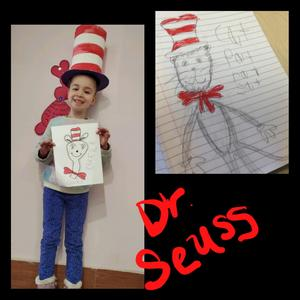 Student in cat in the hat hat and drawing