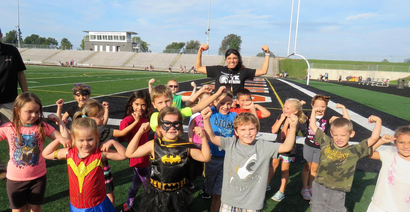 Ms. Mitchum's class of superheroes shows their muscles.