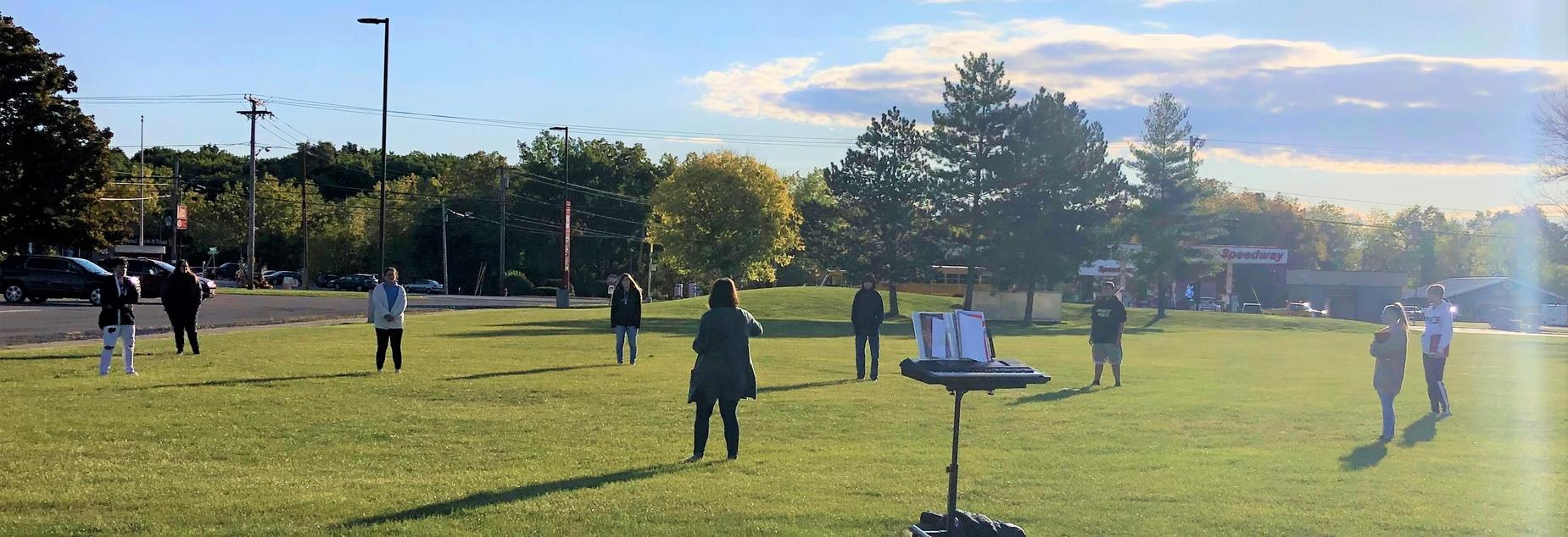 Choir practicing outdoors